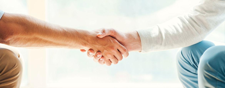 Handschlag zur Eigentumsverwaltung